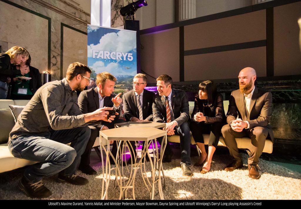 Ubisoft's-Maxime-Durand,-Yannis-Mallat,-and-Minister-Pedersen,-Mayor-Bowman,-Dayna-Spiring,-and-Ubisoft-Winnipeg's-Darryl-Long-playing-Assassin's-Creed(low)